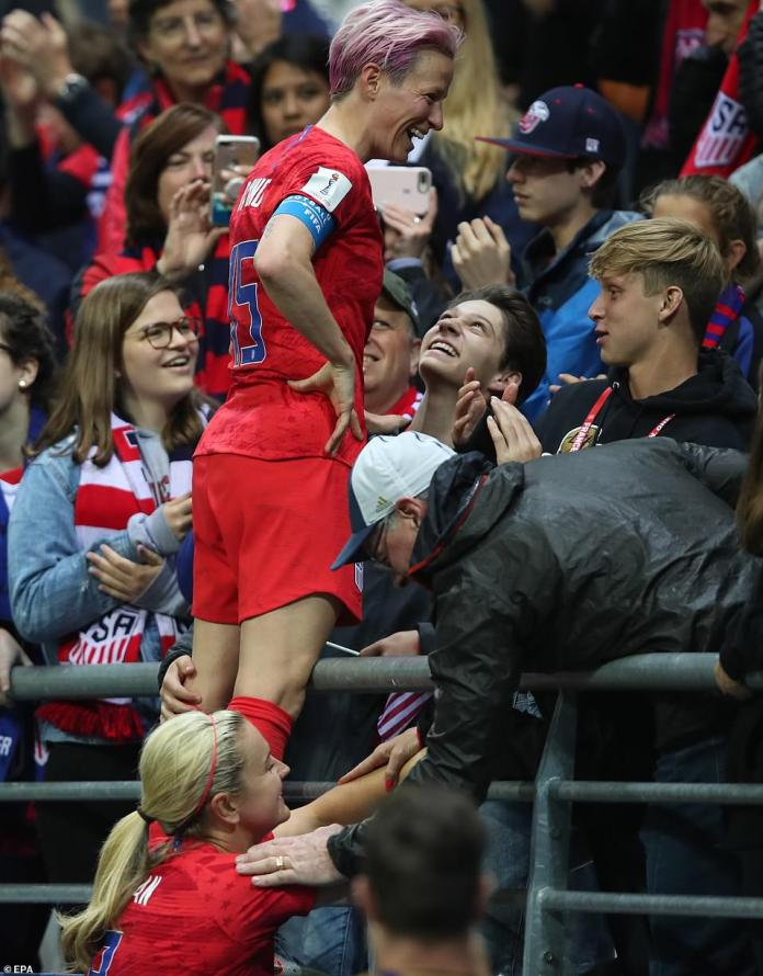 Megan Rapinoe celebrates with fans after winning the FIFA Women's World Cup 2019 preliminary round match between USA and Thailand in Reims