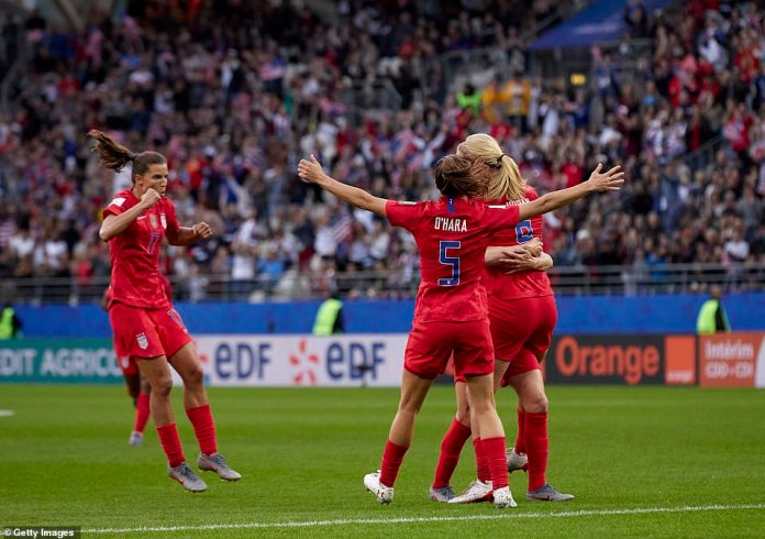 Players of USA celebrate their team's first goal against Thailand in the World Cup