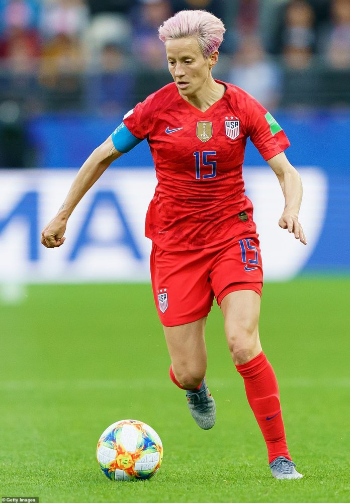 World Cup history with a thumping 13-0 win over Thailand. Rapinoe is pictured controlling the ball during the game