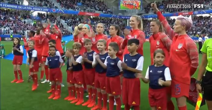 When the 'Star-Spangled Banner' ends and players clap, Rapinoe raises her fist in the air