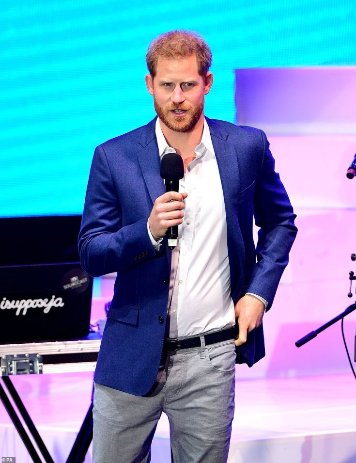 A smartly dressed Duke of Sussex, pictured, also took hold of the microphone to make a speech on stage at his charity event