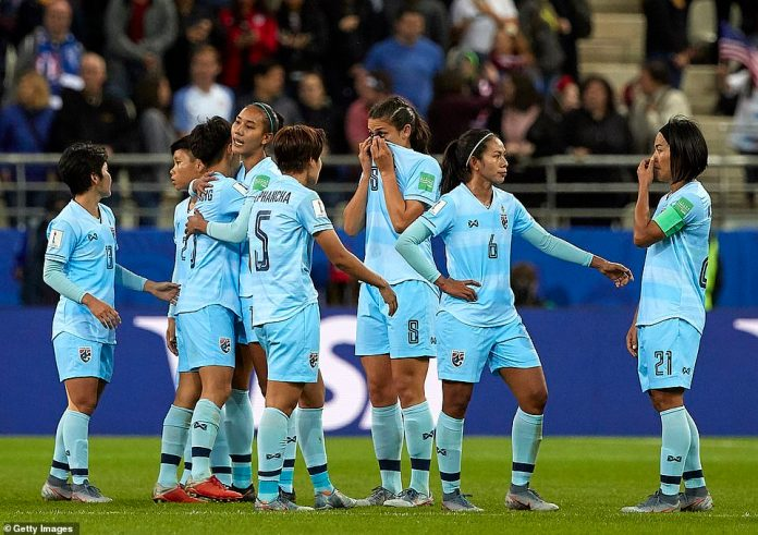 Emotional: Thai players embrace each other at the end of the 2019 FIFA Women's World Cup France group F match against the USA