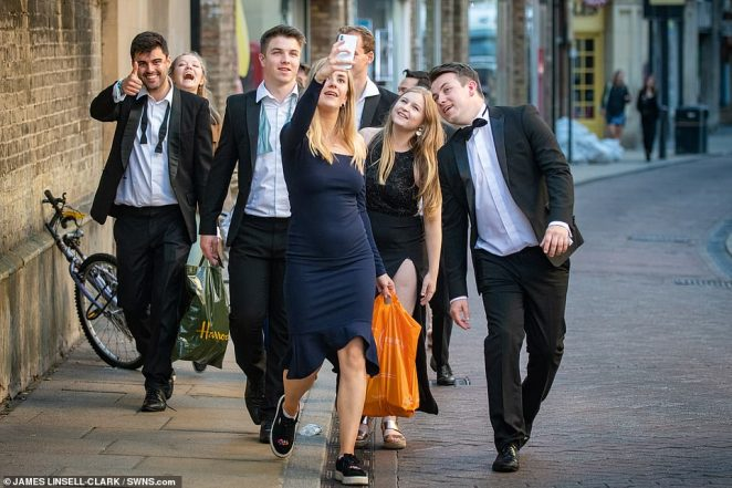 Guests make sure to take a selfie after the celebration which is the biggest event in each college's social calendar with tickets costing £190 for the party at Emmanuel College