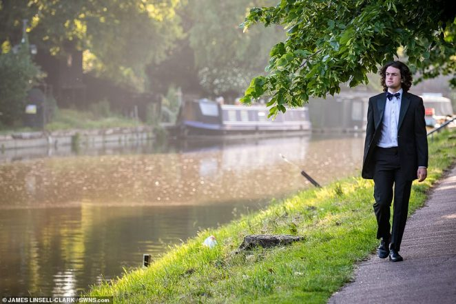 One ball attendee enjoys a soothing walk by the River Cam after the night's excesses as the students make their way back to their accommodation