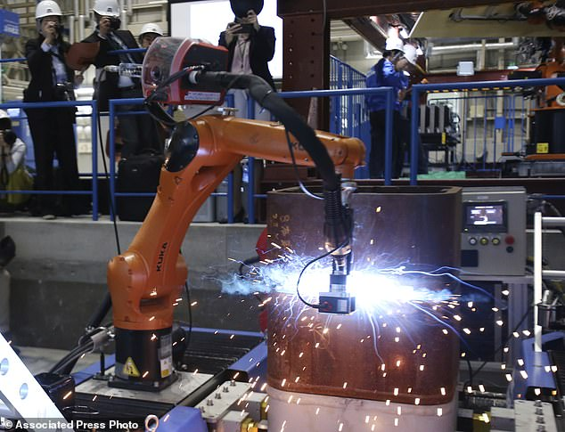 For the robot to feel and see, the team took a KUKA robot arm (pictured), a machine often used in warehouses, then outfitted it with GelSight, a type of tactile sensor that's made of rubber