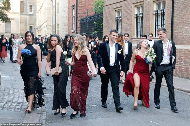 The historic streets of Cambridge were brimming with students in the early hours of this morning as they were captured in what is traditionally known as the 'survivor photos'