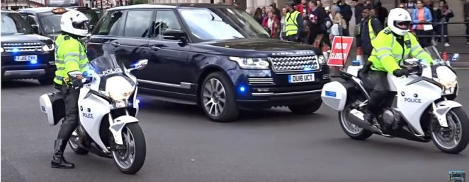 The Duke and Duchess of Cambridge travel in a Range Rover escorted by police motorcycle outriders and royalty protection officers