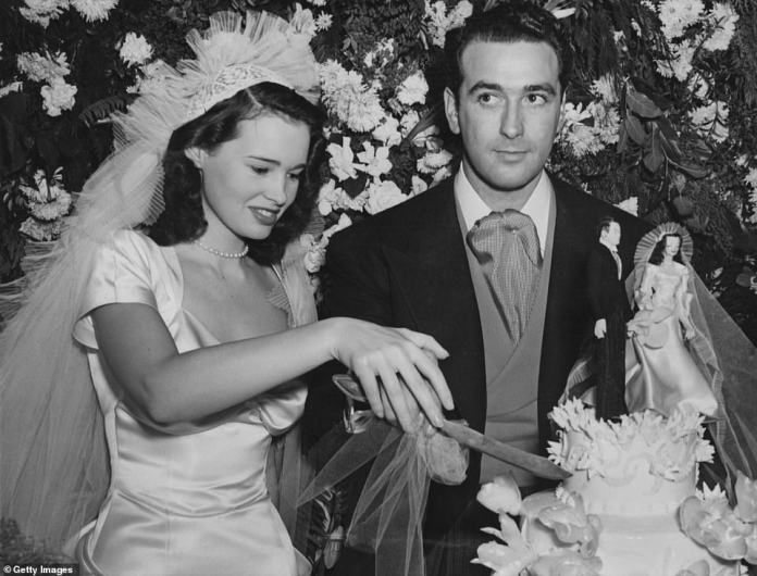 Early start: Vanderbilt was only 17 years old when she married her first husband, agent and film producer Pat DiCicco (above, 1941)