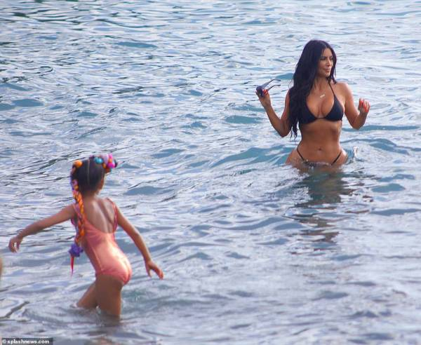 Family fun! North, five, appeared to be having a fantastic time on vacation as she played in the water with her mother