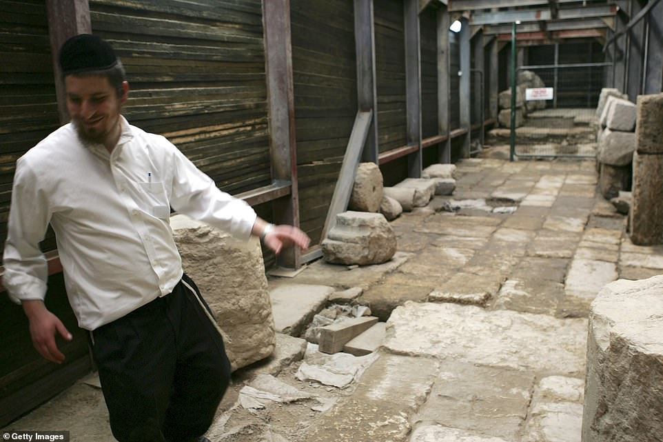 An ultra-Orthodox Jew walks along part of the 2,000-year-old road after it was officially unveiled to the public on Sunday