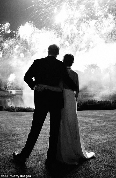 Harry and Meghan opted for this snap of them standing with their backs to the camera as their first Christmas card