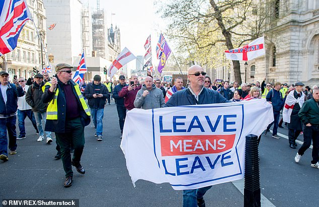 Resolving Brexit should be the Government¿s number-one priority ¿ and is more important to voters than issues such as climate change, according to a new survey. Pictured: Pro-Brexit protesters marching around Westminster in April