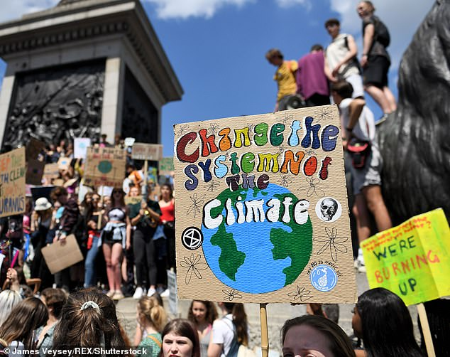 Climate change came third in the list of priorities voters identified for the Government ¿ 11 per cent mentioned it. Pictured: School students walk out in global climate strike in Trafalgar Square in May
