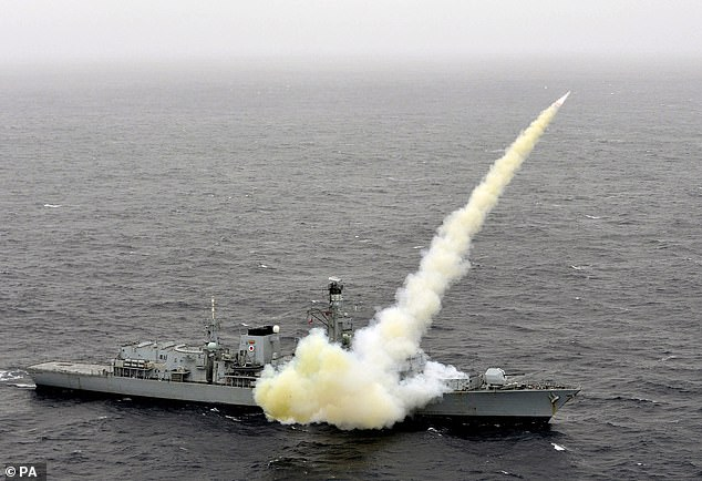 The HMS Montrose (pictured firing a missile on exercise in 2013) was also said to have trained its guns on the Iranian vessels, before they backed off without a shot being fired