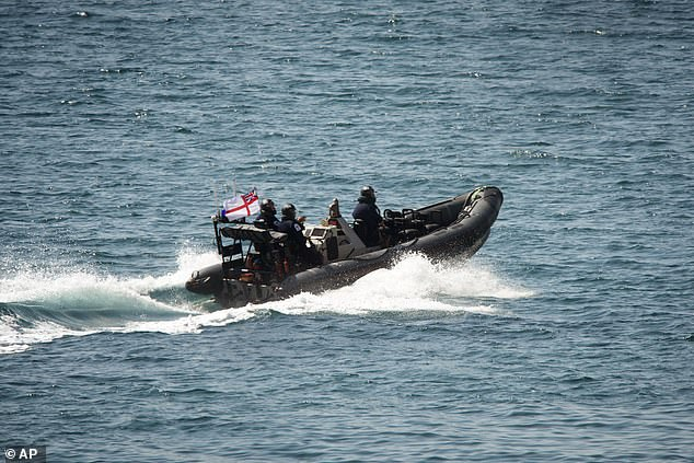 Britain has accused Iran of attempting to sail oil to Syria, in breach of EU sanctions against the country which came into force in 2011 (pictured, Marines sail near the Grace 1 tanker)