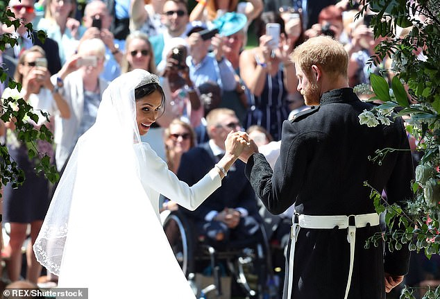 Smitten: On the day they said they feel 'so lucky' to have shared their big day with 120,000 people in Windsor and millions watching around the world