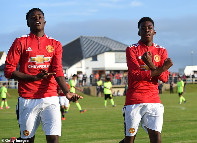 The 16-year-old (L) scored 35 goals for United's academy last season but will now exit