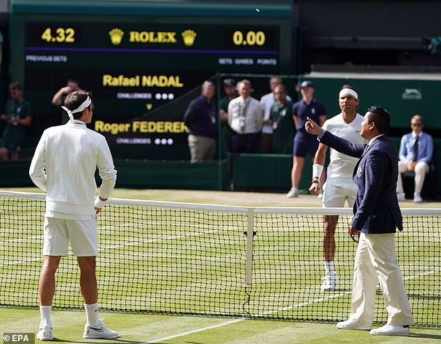 British umpireJames Keothavong flips a coin as Federer and Nadal watch on before the match
