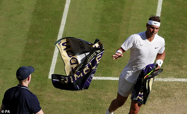 Nadal launches his towel back to the ball boy as he tried to level the match in the second set