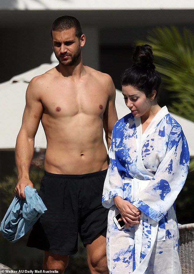Getaway: Martha arrived in Cairns last week with her boyfriend Michael Brunelli (left). The MAFS couple havebeen staying at the five-star Crystalbrook Collection Resort
