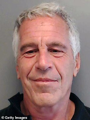 Prosecutors claim Epstein had a false Saudi passport with his picture in a safe in his mansion, alongside hundreds of naked photographs of women and girls, 'piles of cash' and 'dozens of diamonds'