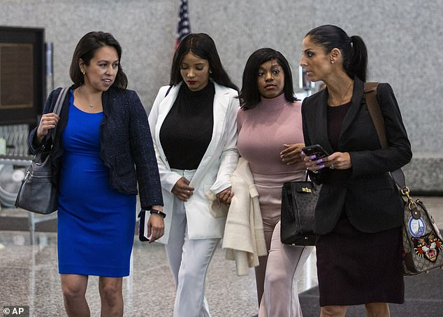In court: Joycelyn Savage (second from left) and Azriel Clary (second from right) arrived in court on Tuesday to support Kelly (the attorney for the women Gloria Schmidt on left)