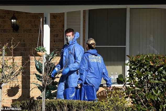 Forensics officers investigate the scene of the crime outside the house in western Sydney