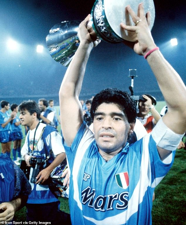 Diego Maradona lifts the Italian Super Cup after Napoli's5-1 win over Juventus in 1990