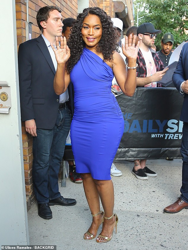 Beauty in blue: She arrived for her appearance on The Daily Show with Trevor Noah, sporting a sexy blue bodycon dress