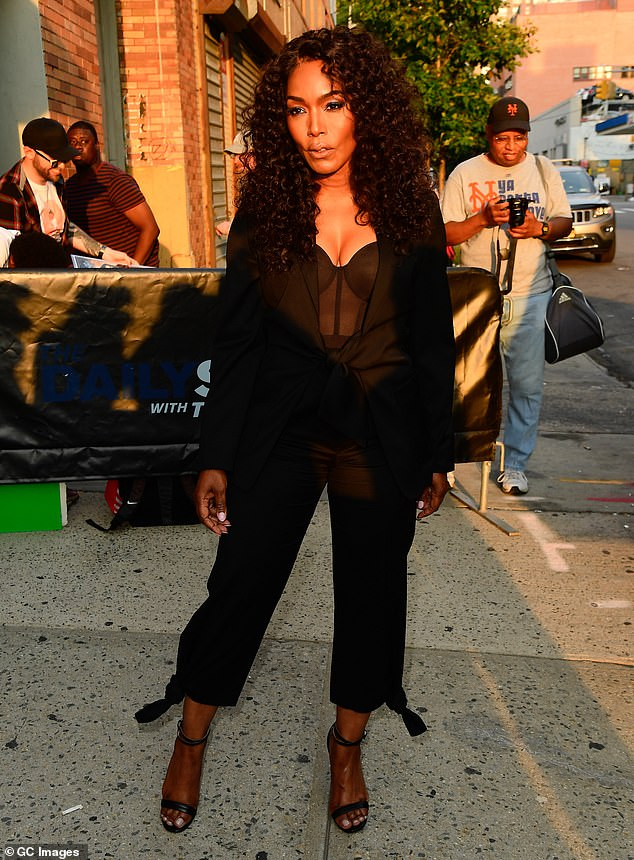 Big girl pants: She wore a black pantsuit, which was tied at the waist, as well as at the hem of the pants