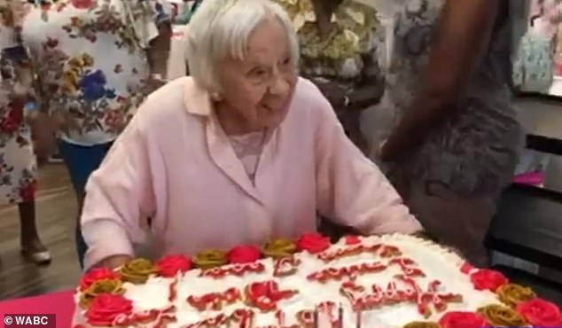 Long-term Bronx residentLouise Jean Signore celebrated turning 107-years-old on Wednesday and blew out candles on an ornate cake (above)