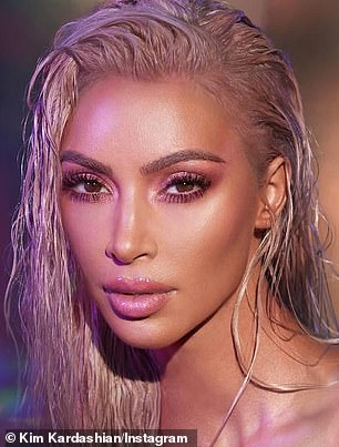 Compare: Kim showed off some smaller changes in an ad for her eye shadow and lip gloss in which her eyes were lightened to a deep golden color from their usual dark brown shade