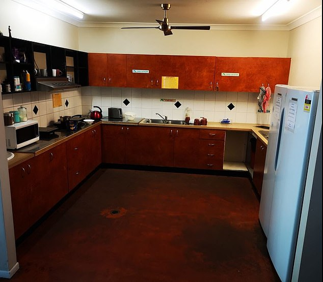 The 26-year-old backpacker was in the kitchen of the inner-city hostel (pictured) about 11am on Monday when the cleaner allegedly grabbed the knife from the communal kitchen