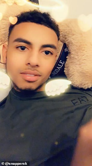 The 20-year-old, pictured,was killed while playing football in the street with his friends