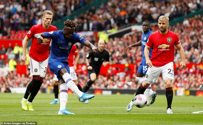 Chelsea forward Tammy Abraham works some space in a tight area and lets fly but his effort also rattled the United post