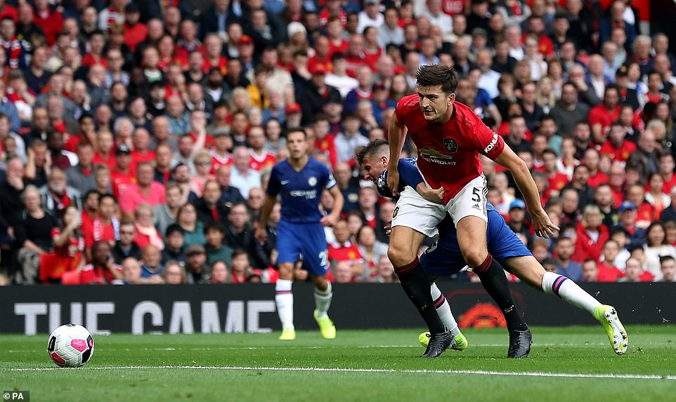Harry Maguire uses his strength to hold off Chelsea midfielder Mason Mount during the first half at Old Trafford