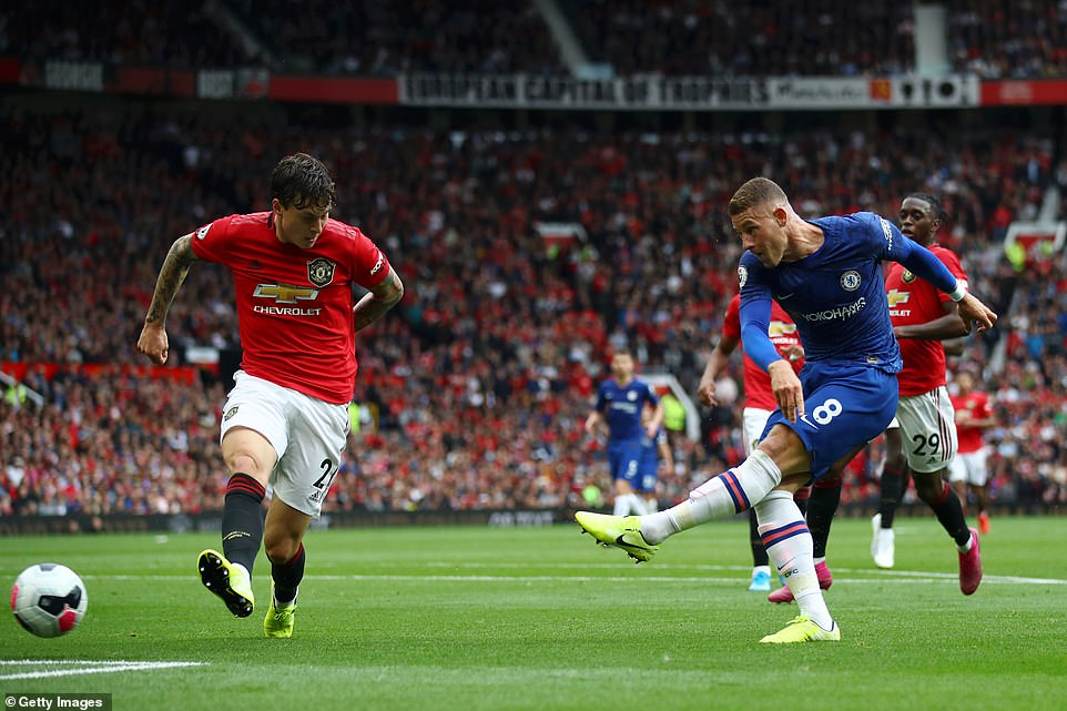 Ross Barkley strikes a powerful left-footed effort at goal from close range but David de Gea keeps it out with his feet