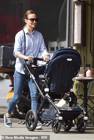 New mother Pippa sported her favourite navy blue and white velvet trainers by Penelope Chilvers