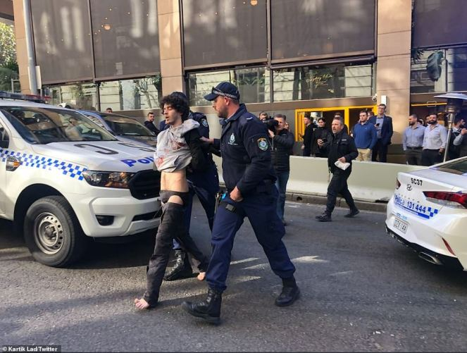 The suspect was taken away after being arrested by police (pictured). Although the incident is not being treated as terror-related, the knifeman was described by police as a 'lone actor' who may have some terrorist ideologies