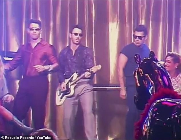 Blast from the past: The Jonas Brothers got the party started in the retro video for their track Only Human, which came out on Tuesday
