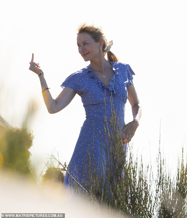 Feeling blue? While her hand gestures weren't so pretty, the 50-year-old Australian actress looked stunning in a bright blue dress