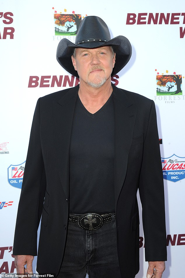 Film star: Adkins, 57, arrived for the screening in a black stetson with a black top under a black tailored jacket and black jeans fastened with a large black and silver belt buckle