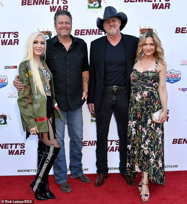 Pals: Adkins is featured on Shelton's new single Hell Right which will be released on Friday and the two couples posed up a storm together on the red carpet