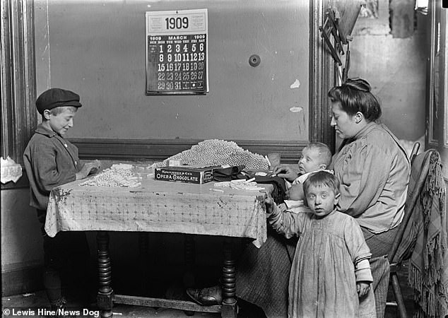 A widow and her son are pictured here rolling hundreds of cigarettes in their tenement in New York in 1908. It's estimated that 18 per cent of all workers in the US workforce in 1900 were children. By 1910, the number shot up with two million kids working in menial jobs