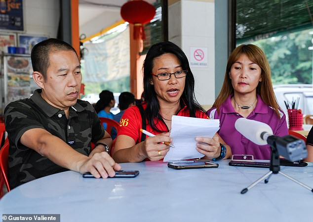 Kenny Chan (left), Shirley Yap (centre) and May Lou (right), who were also among the search party which found Nora, give a statement to the press