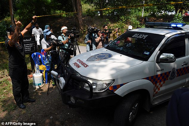 Emergency services and rescue workers arrive at theDusun Resort, where Nora went missing from her family's apartment on August 4