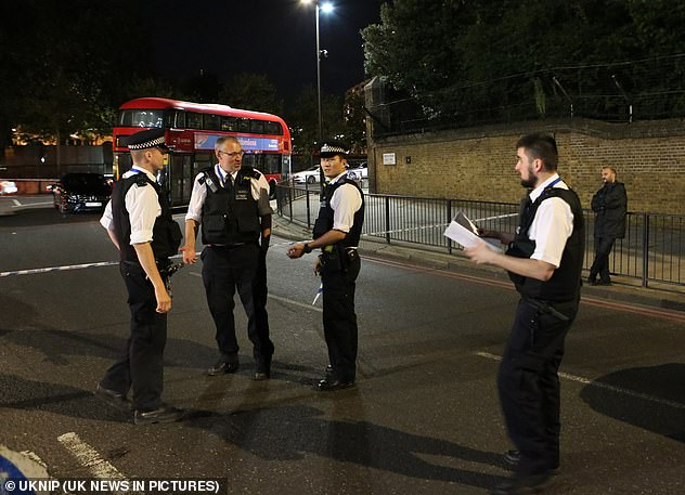 The police built a barrier on Sunday after the incident at a busy intersection in Hyde Park Corner