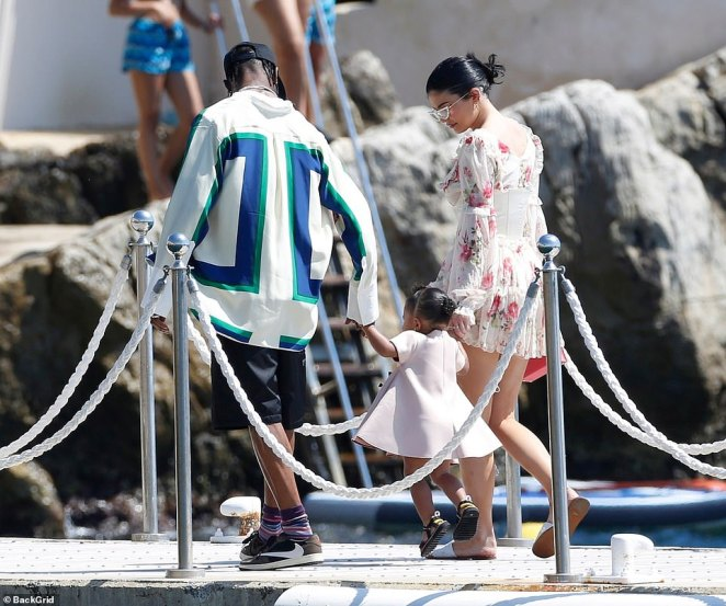 Special family moment: Travis and Kylie picked their beautiful daughter Stormi, 18 months, up in the air and swung her forwards, much to her delight