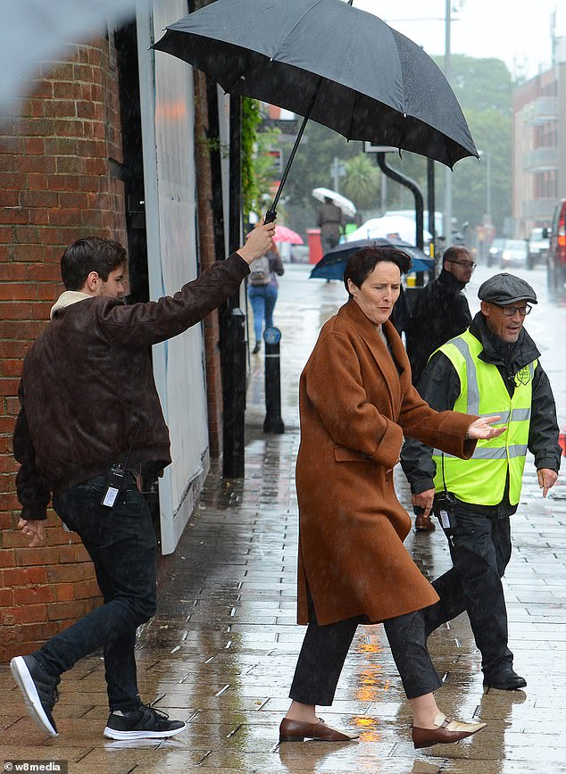 Filming:The Harry Potter star wore a pair of black trousers with an oversized camel coat over the top and stylish brown loafers