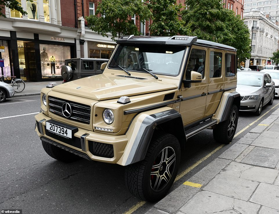 A Mercedes G500 is parked outside the likes of Prada and Giorgio Armani - shops the owner can no doubt afford to buy from